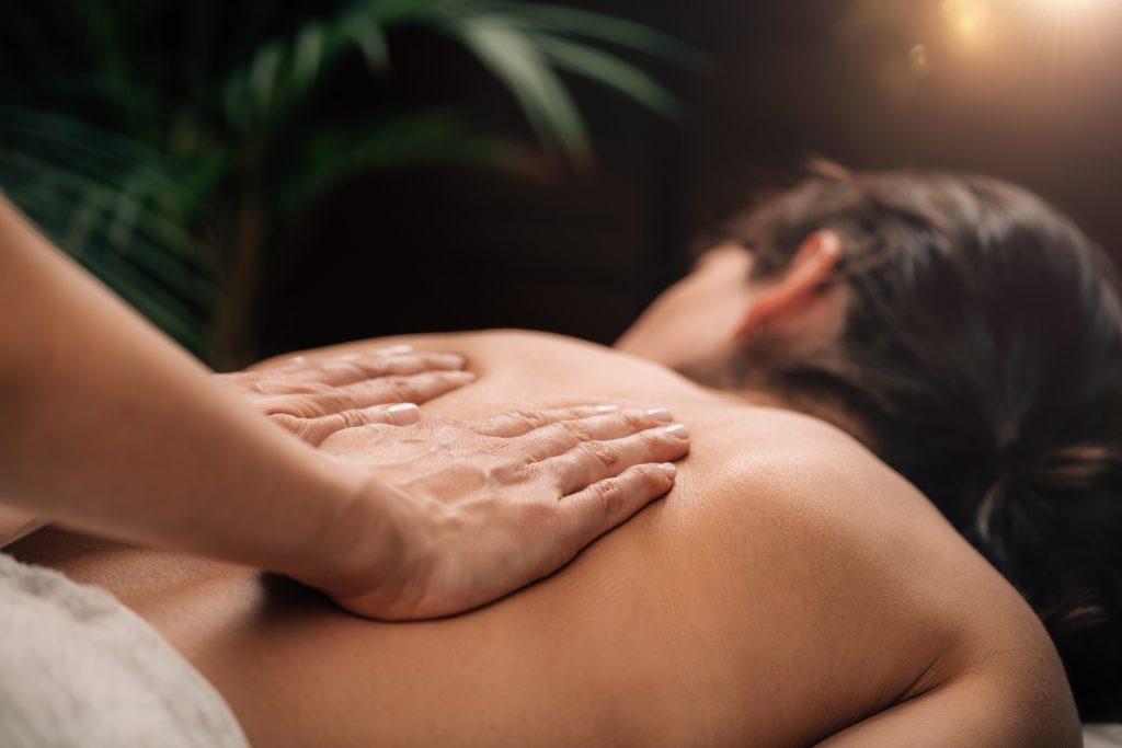 Deep Tissue Massage Therapy. Therapist massaging Woman's Back